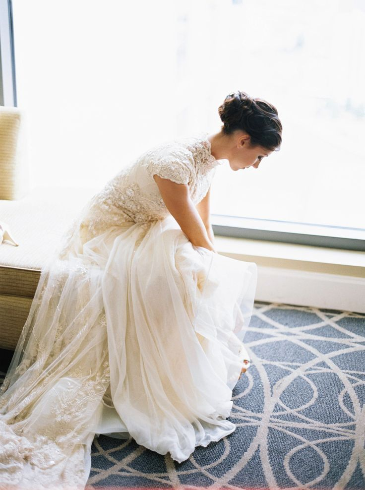 modest wedding dress with a high neckline and cap sleeves from alta moda (modest bridal gown)