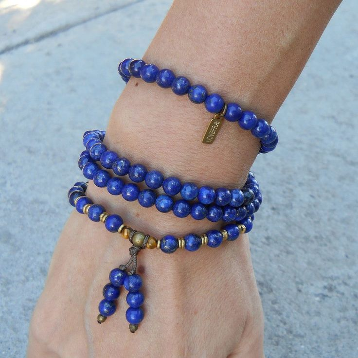 Beautiful piece, with 108 beads, made with Lapis Lazuli gemstones. It will wrap as a bracelet (its made with hitec elastic), and doubles as a mid length necklace... Lapis Lazuli encourages self-awaren