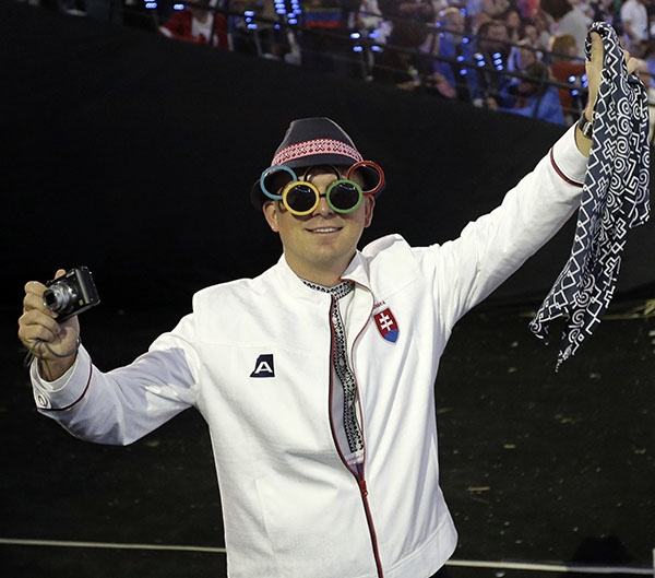 A Slovakian athlete takes in the activities during the Opening Ceremony at the 2012 Summer Olympics, Friday, July 27, 2012, in London. (AP Photo/Matt Slocum)