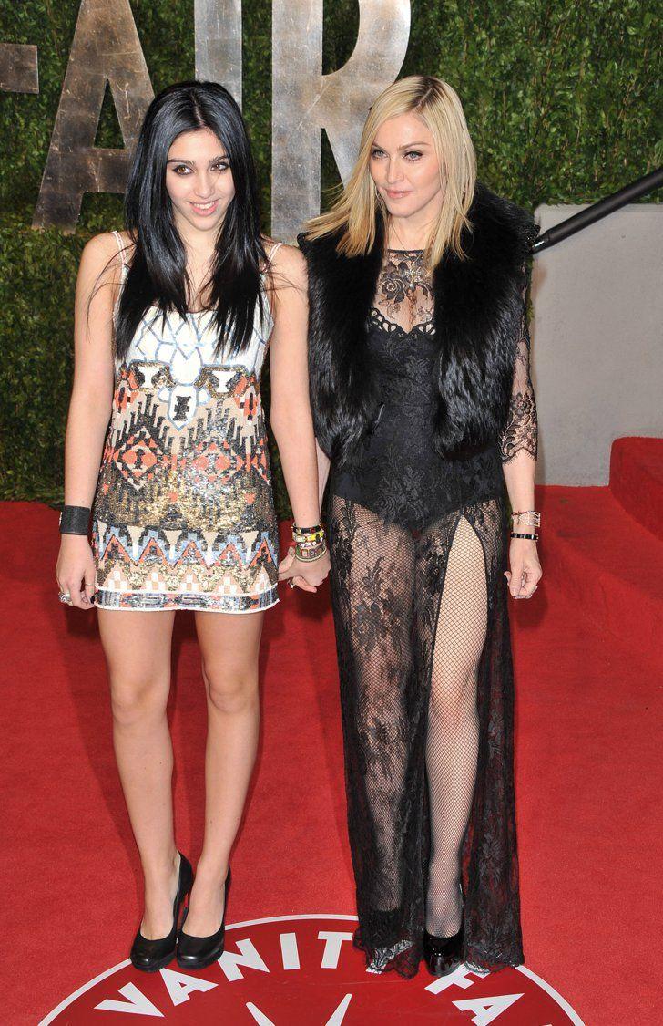Pin for Later: Von Geisha zu Cow-Girl und Punk-Lady: Madonna's größte Mode-Statements  Mit Tochter Lourdes im Jahr 2011.