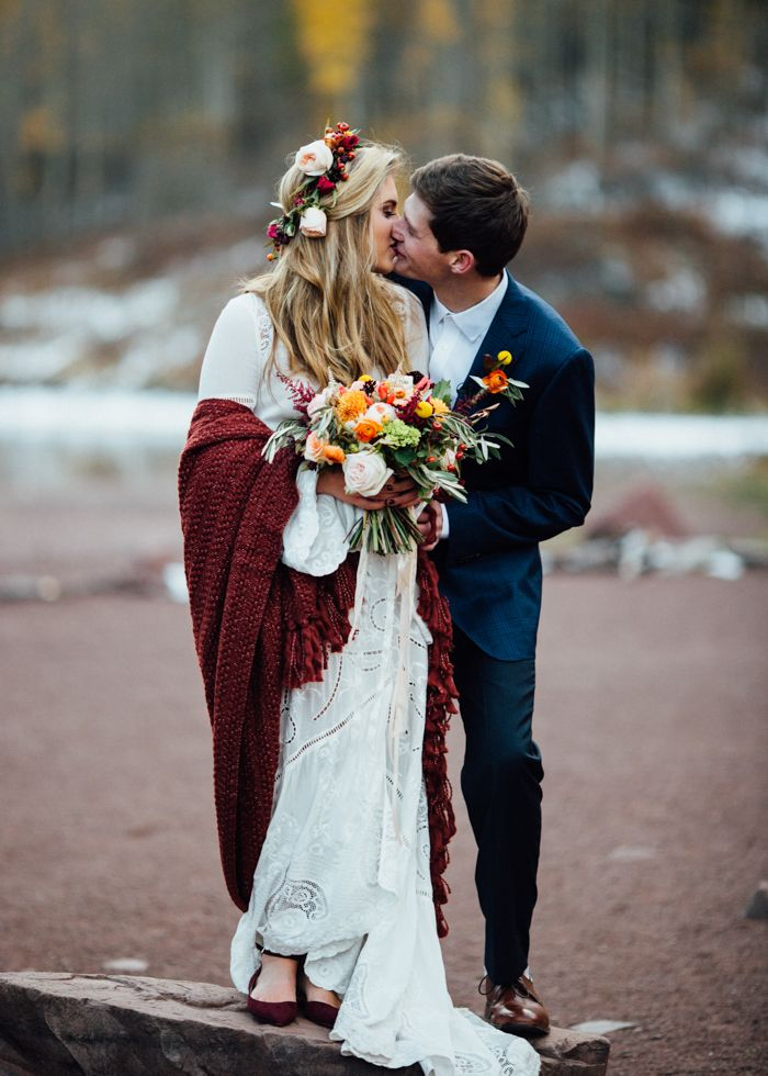 newlywed kisses from this Aspen elopement captured by  Cat Meyer Studio
