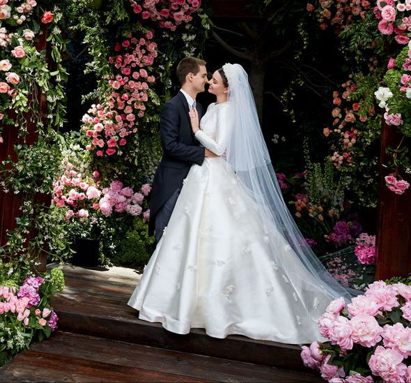 Miranda Kerr marries Snapchat founder Evan Spiegel in stunning Dior gown - http://buzznews.co.uk/miranda-kerr-marries-snapchat-founder-evan-spiegel-in-stunning-dior-gown -