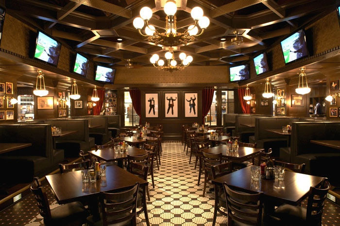 Harry Caray's Tavern on Navy Pier. Beer, greasy food, sports.