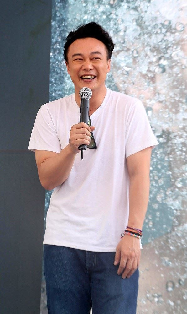 Hong Kong singer Eason Chan continued the promotional tour for his new Mandarin album 'rice and shine' in Taipei, Taiwan, July 13, 2014. Singaporean signer JJ Lin, the producer of Chan`s new album, was on hand to show his support