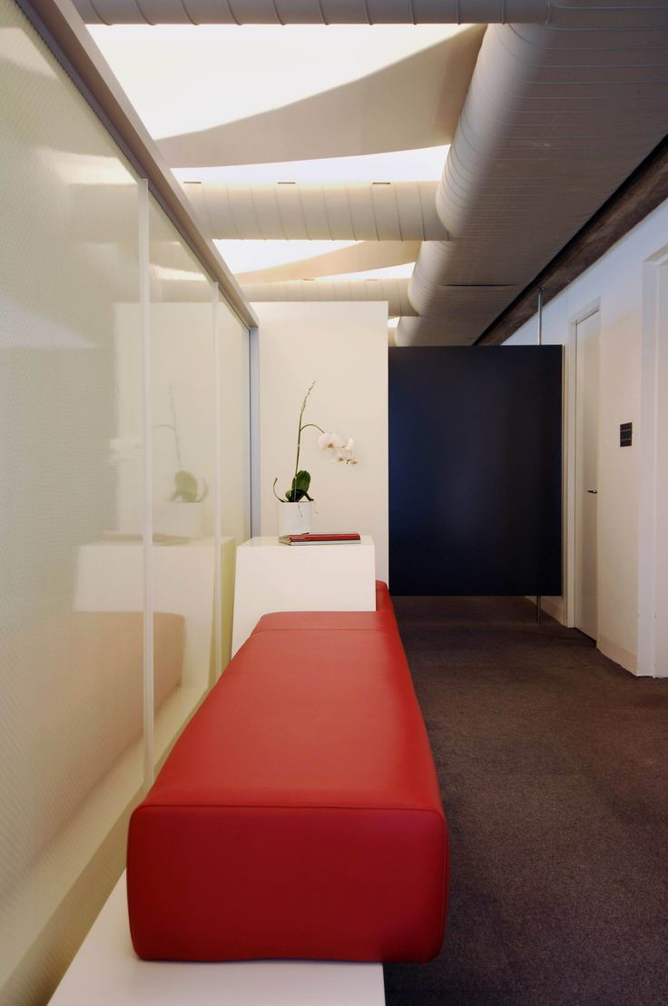 the Entry is a small waiting space bound by BAF panels that let light and movement through but hide the working space. Brooke Aitken Design.