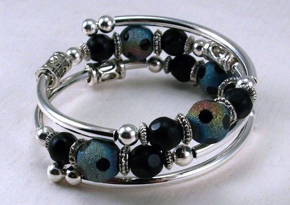 I love the rainbow beads, wish I knew where to get them!  Memory wire and tube bead bracelet.
