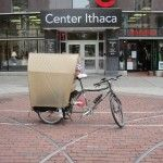In a previous post I described a canopy that Thea and I made for our Xtracycle to protect her from wind and rain. It looks sort of like a covered wagon on the back of our bike. It was easy to build…