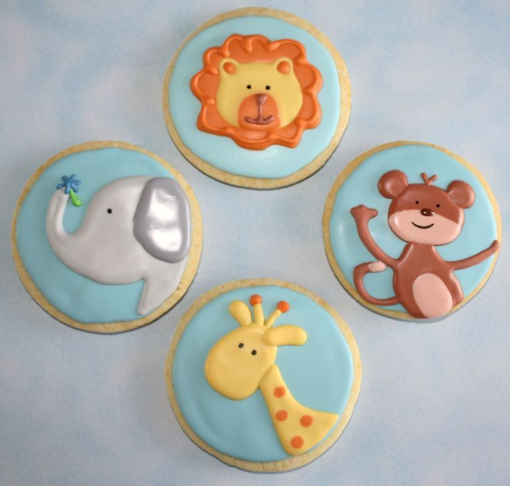Baby Shower Cookies - These were made for favors for a Noahs Ark themed baby shower. I got the inspiration for the animals off of my sons newborn pj's and blankets. They are iced in a glaze and are lemon sugar cookies.