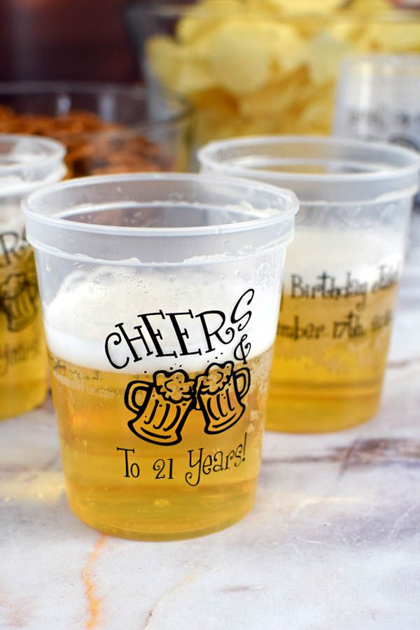 Cheer his or her 21 years with beer served in 16 ounce plastic stadium cups personalized with a 'cheers' design, the birthday celebrant's name and up to 4 lines of custom print. The reusable, dishwasher safe cups can be taken home after the party as souvenirs that can be used again and again. Use personalized birthday souvenir cups for beer pong, beer kegs, and mixed drinks. These reusable party cups can be ordered at http://www.tippytoad.com/16oz-personalized-adult-birthday-party-cups.asp