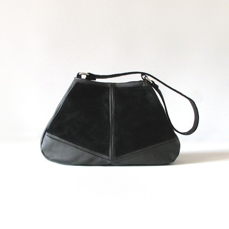 The sleek handmade Diamond Hobo handbag is made from quality charcoal cowskin leather with black jersey suede panels.