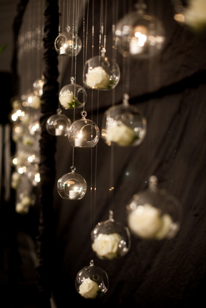 Hanging tealights and baubles with flowers as a feature behind the bridal table, so cute!