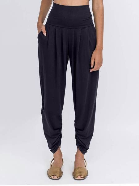 The best selling Sunday Pant. Draped bamboo nylon with flattering pleats, deep pockets and a high-rise roll down waist. Too comfy.