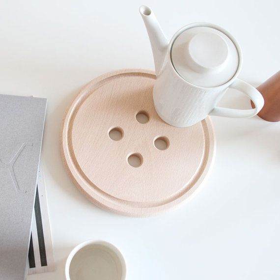 Love this - so simple. A wooden button trivet. I need access to a router!    snugbuttonboard by snugstudio on Etsy, $27.00