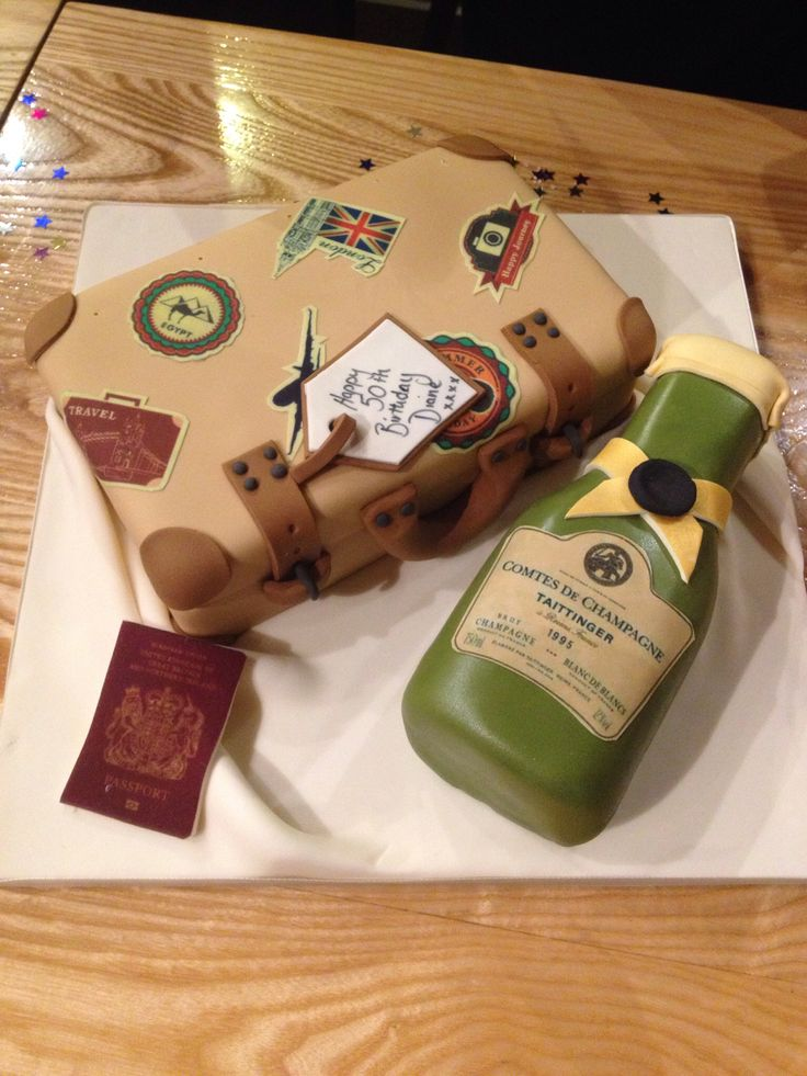 A well travelled suitcase and champagne cake