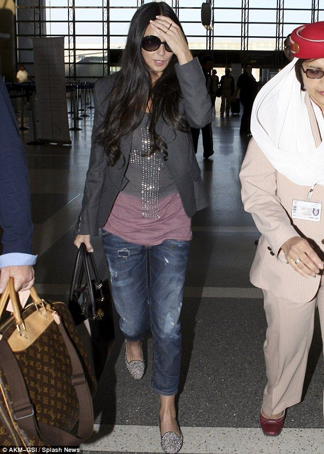 Low key lady: Demi Moore still looked glamorous despite her lwo key outfit as she arrived at LAX airport on Friday