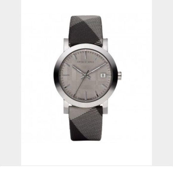 Burberry Large Check Leather Strap Watch Stock photo is only one I could find. Dial is actually metallic white not gray. Item in great condition, unfortunately I no longer have the original box. Burberry packaging is super insulated and didn't want to hang on to such a large box at the time. Item is 100% authentic. Purchased at Nordstrom yrs ago. No signs of wear except portions of cloth on band are dirty. I was told that it could me removed with mild soap and toothbrush or just replace the…
