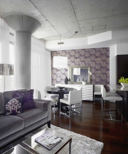 Grey white and purple living and dining room space.