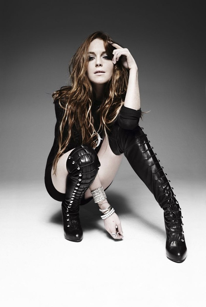 Rankin photography - powerful dressing The boots lindsey lohan is wearing come from the punk, metal, fetish fashions which symbolises differant levels of power.