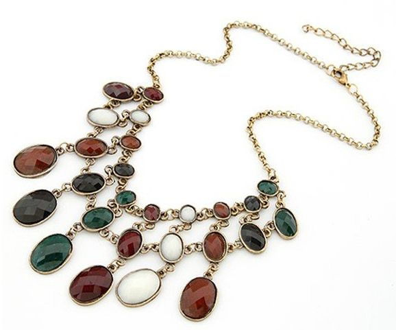 """Gold Necklace with Tri Coloured Stones Product ID               : N0016 Main Colour             : Gold,Red,White,Green Available Colours      : Gold,Red,White,Green Price                       : CAD 12.90 Style                       : Choker Metal Type              : Zinc Alloy Main Stone              : Crystal Necklace Length       : 19"""""""