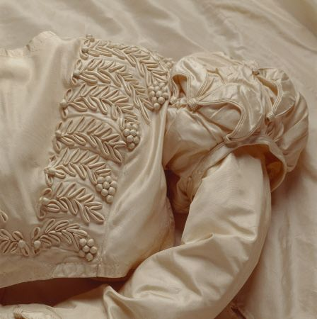 Detail of the white silk wedding dress worn by Mary Elizabeth Williams when she married George Hammond Lucy on 2 December 1823.