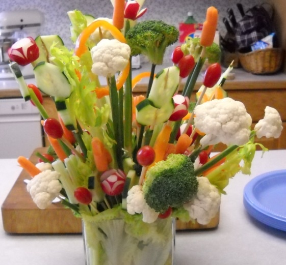 Vegetable centerpiece:  Get creative with an edible veggie bouquet, which doubles as a centerpiece.