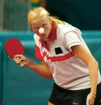 Funny In The Moment Photo - Woman playing table tennis aka ping pong