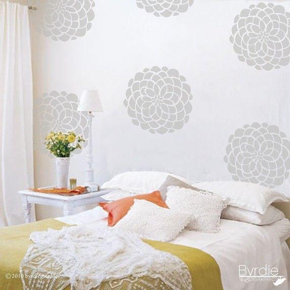 Flower decals....looks like wallpaper! Thinking on a pale blue or grey wall? (etsy)