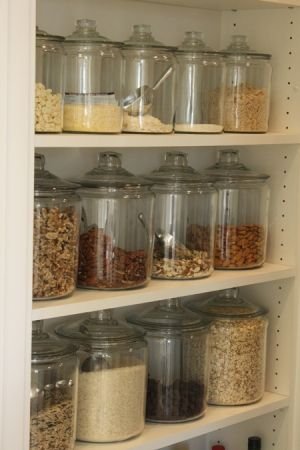 Pantry storage, glass containers with nuts, oats, grains, flour, sugar