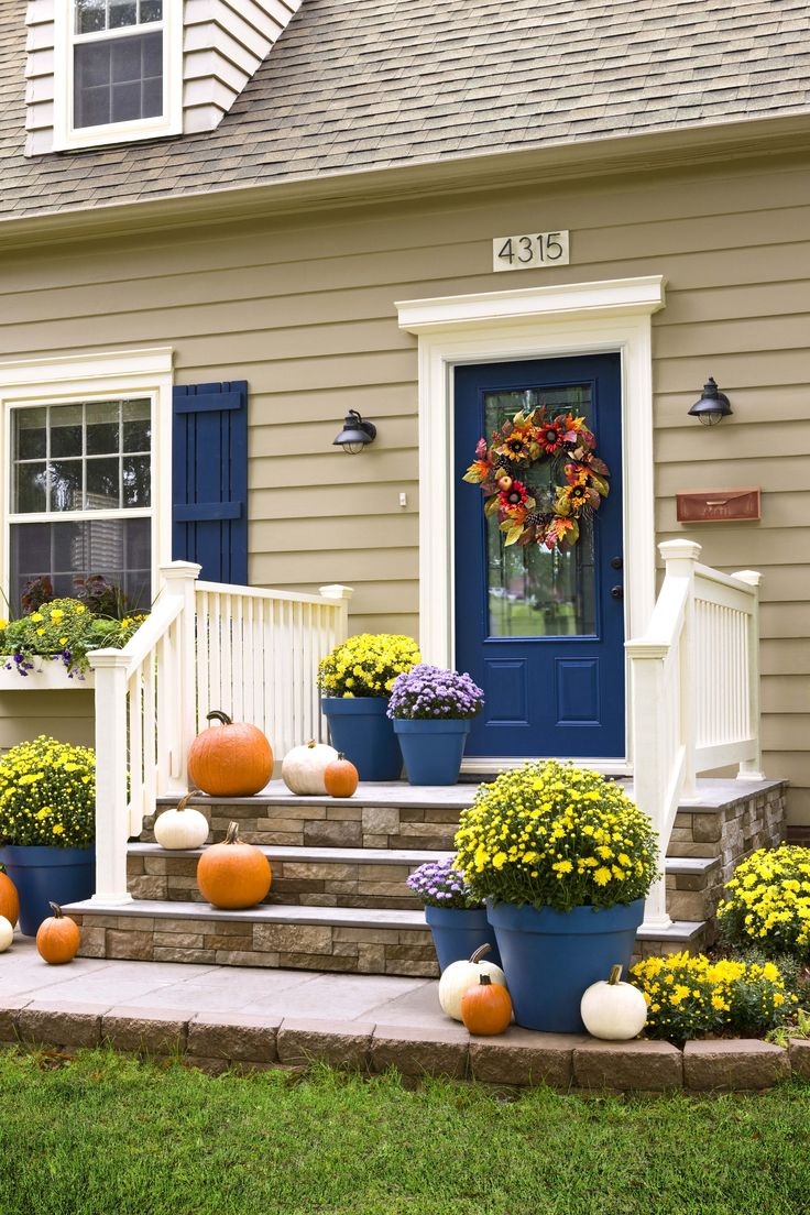 Add to the curb appeal of your house -- and increase its value -- with these easy exterior improvements. Welcome autumn in all its glory with a fall-themed door wreath. This ready-made decoration brings together a colorful mix of faux flowers, leaves, and other signs of the season. Best of all, it's reusable year after year. Transform a slab and steps with the high-end look of stone. Then update a basic mailbox with gleaming copper spray paint.: