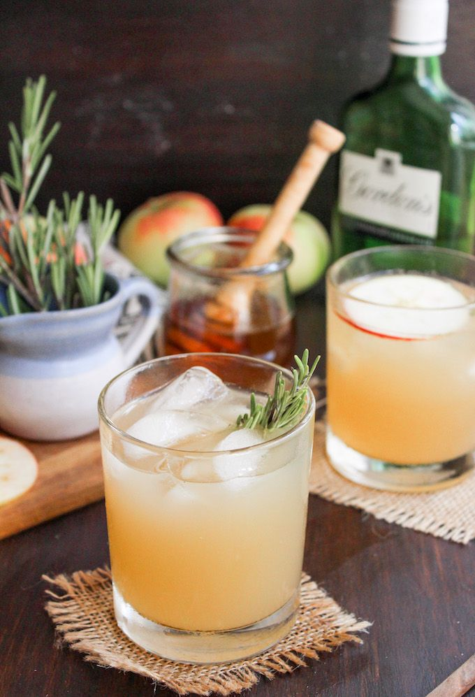 This apple bees knees cocktail adds a seasonal twist to the classic gin cocktail | made with a rosemary infused simple honey syrup