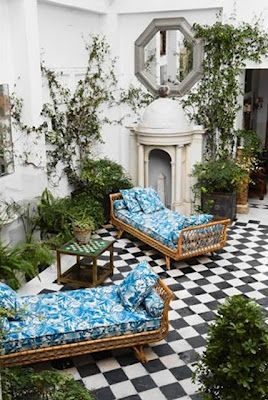 Love the black and white tile and pop of teal...lovely little get away space in the Garden!