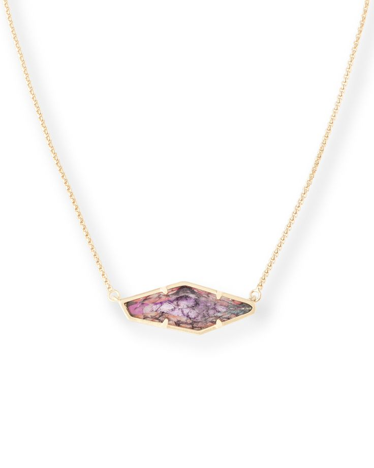 Shop gold pendant necklaces in a custom navy crackle stone from Kendra Scott Jewelry. Layer it up or wear it alone, it's this season's must-have accessory.