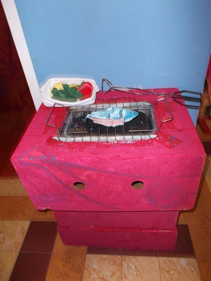 Een barbecue maak je gemakkelijk van van karton.