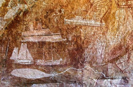 """Amazing Rock Art May Revise Australian History Books: """"Thousands of Aboriginal rock paintings have been discovered in the remote ranges of northern Australia, archaeologists announced recently.    Drawings of Indonesian sailing boats called praus (above) suggest that Aboriginals had extensive contact with neighboring cultures perhaps hundreds of years before the British settled Australia in the late 1700s."""" Article Carolyn Barry (Oct 22, 2008). Photograph: Rick Stevens."""