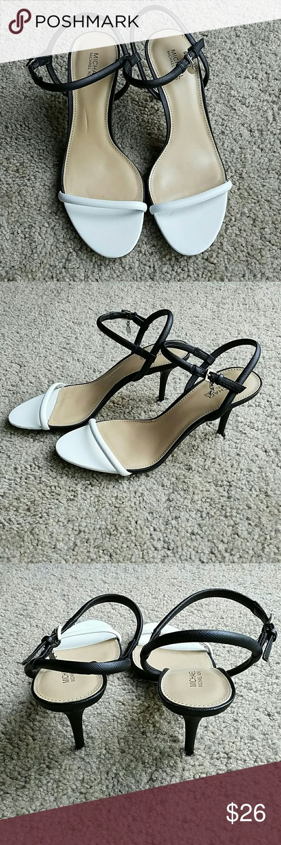 """Michael Kors Black and White Heels Re-posh because even though I love them, they're just too small! Black and white strappy heels, very elegant. As far as I know, never worn outside. Leather, silver buckle and MK logo. Heels 3"""". Length of strap over toes is only 4"""" across so measure your foot! I wear 7.5 or sometimes 8s and have very narrow feet, these are definitely too small, both in length, and width at toes. I think they may actually fit a 7 better than 7.5. Listing at price I paid…"""