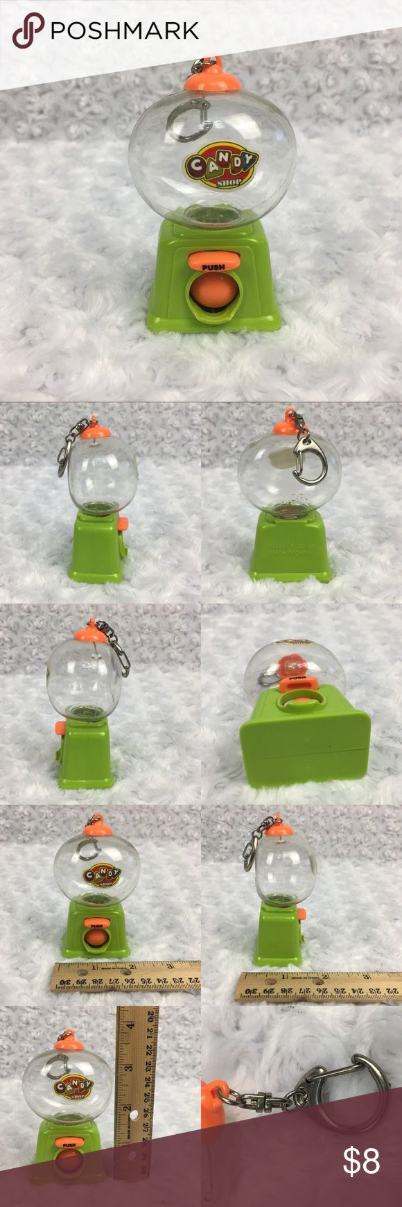 "Bubble Gum Dispenser Small Plastic Keychain Toy Bubble Gum Dispenser Small Keychain Plastic Candy Shop Green Orange Toy   Condition: very light/faint scratches on the clear plastic bubble on top. SEE PHOTOS  * This listing is for ONE (1) Keychain * - Cute bubble gum candy dispenser - when ""push"" button is pushed orange door on bottom opens - clear bubble comes off by twisting & pulling up - candy/bubble gum goes in clear bubble Please note: Color may vary slightly due to different display…"