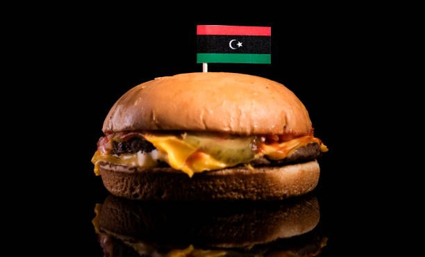 libyan flag on top of hamburger isolated on black background