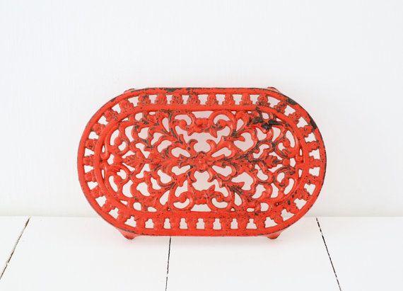 Vintage red cast iron trivet £11