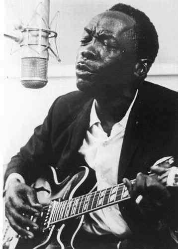 one hand blues guitar player http://gifford.com John Lee Hooker - Blues guitar player