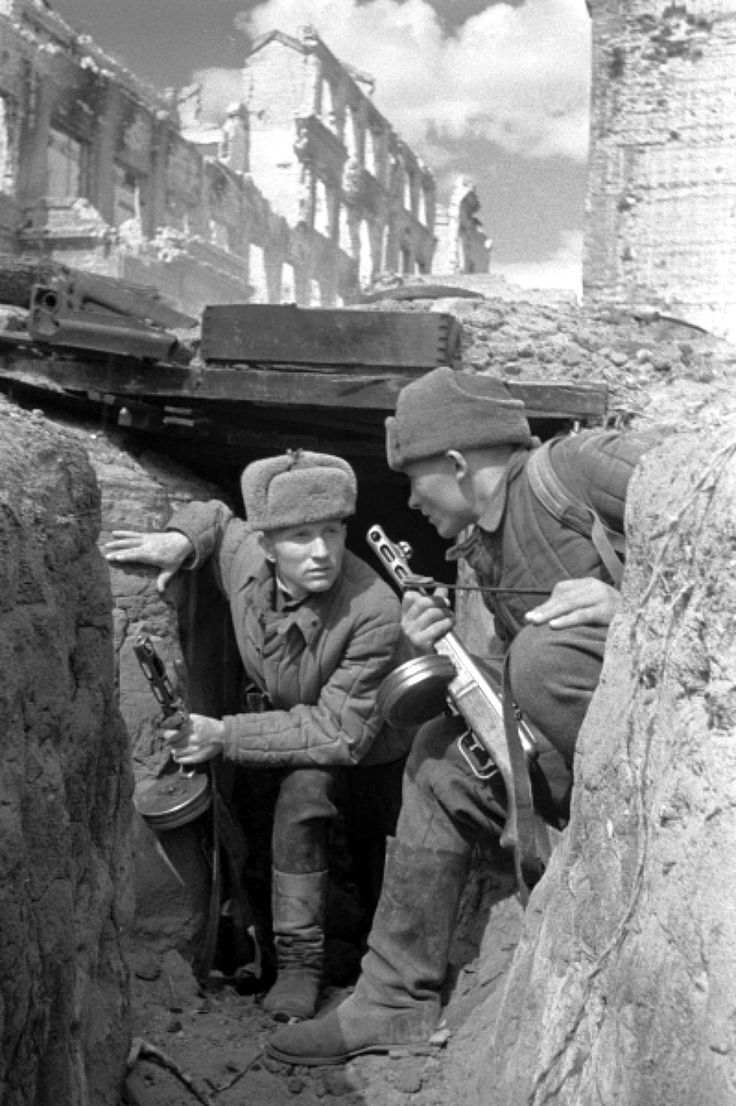 Two Soviet Army soldiers equipped with PPSh-41 submachine guns take cover in a trench during the Battle of Stalingrad which began on 23 August 1942, pin by Paolo Marzioli