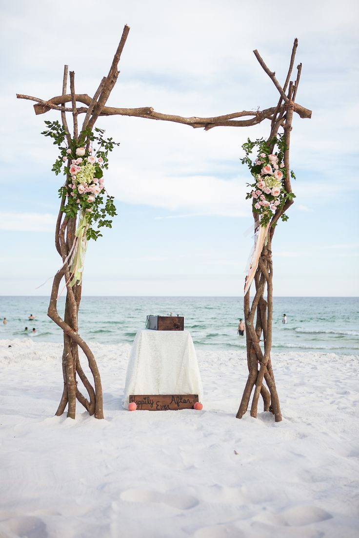PERFECT Rustic Beach Wedding minus the bad flowers and add flowy fabric