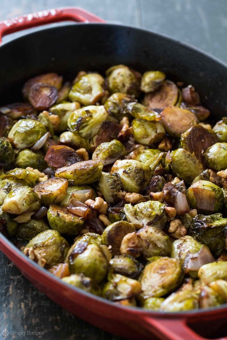 Easy! Brussels Sprouts roasted with shallots, tossed with balsamic vinegar and toasted walnuts. #vegan #Thanksgiving On SimplyRecipes.com