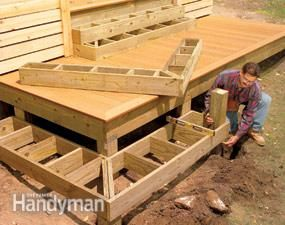 Stack boxes for wrap-around steps, regrade backyard. make it look purposeful by terracing the deck