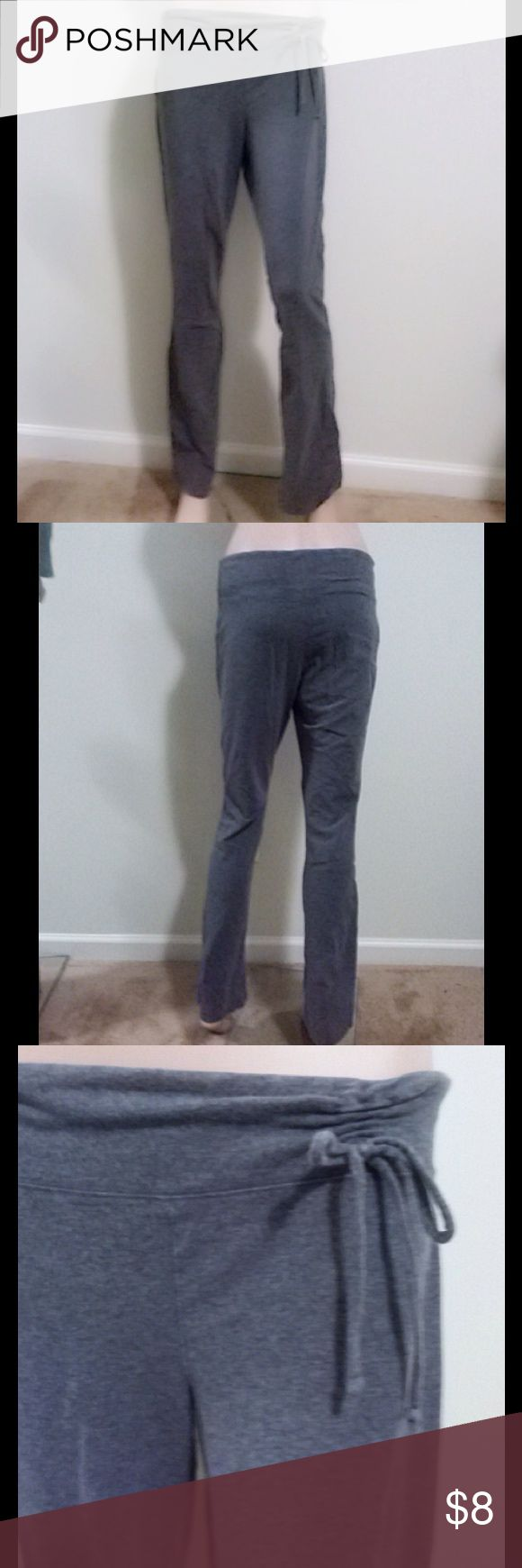 "$4 WITH BUNDLE🌺YOGA PANTS JUNIORS L $4 with bundle. Dark gray yoga pants with cute gathering and bow at side waist. Boot-cut/slight flare bottom. Soft, somewhat stretchy cotton. Size Juniors L, fits more like a Small. Light pilling. Worn a handful of times and in great shape. Maxine is 5'8"" tall. Waist 24"". Hips 34"". Mossimo Supply Co Pants Track Pants & Joggers"