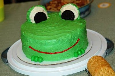 Frog cake with cupcake eyes and peanut M feet...red twizzler for smile maybe??