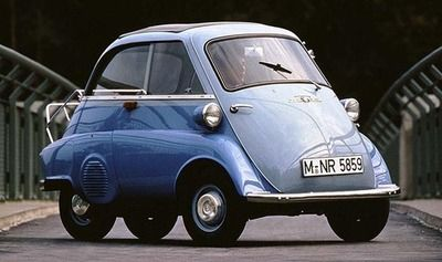 Weather proof motility scotter!! I want one Its an old BMW Isetta. One of the most successful microcars ...