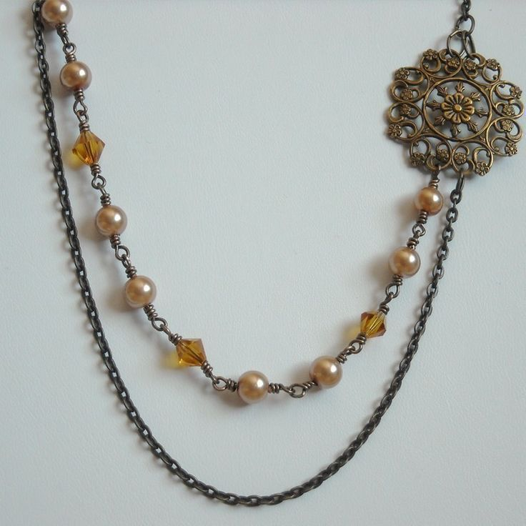 Handmade item                             Materials: pearl, swarovski, crystal, antique gold, filigree, flower, pendant, brass, chain                                                          Ships worldwide from United States