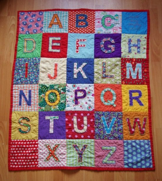 Great alphabet quilt! I think this would be a good use of old baby clothes!