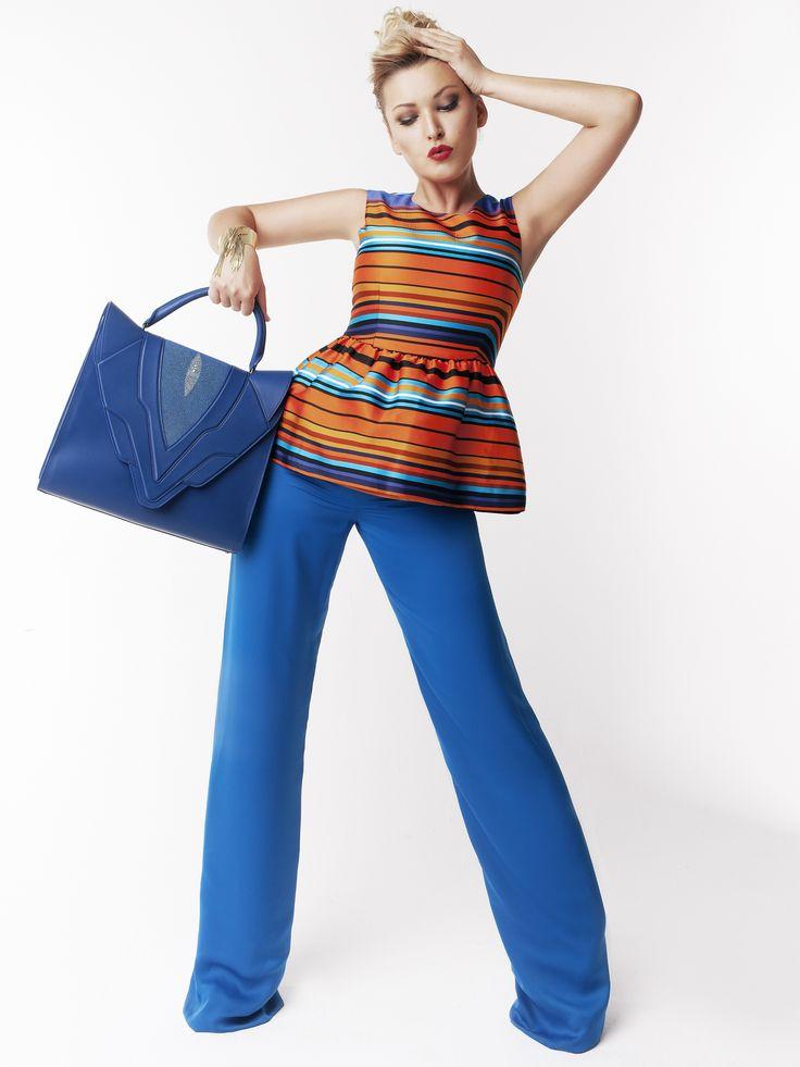 На Ирине Дубцовой топ P.A.R.O.S.H., брюки Mugler, сумка Elena Ghisellini  #topbrands #mugler #elenaghisellini #parosh