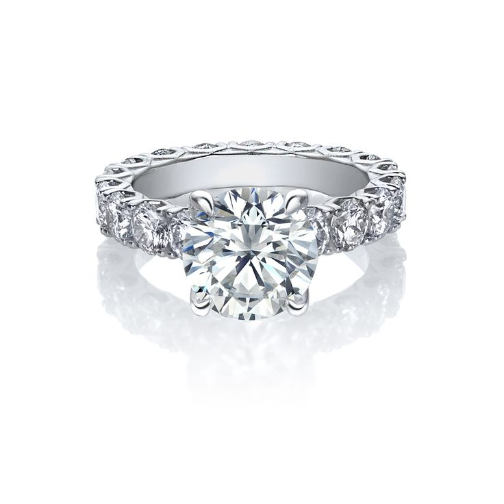 """This splendid engagement ring features a diamond set band with our hand-crafted signature Amira """"V"""" shaped settings, supporting a round brilliant of significance. A timeless creation and a delight to behold. - See more at:"""